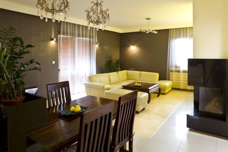 Dining and living room. Dining room & living room in a luxurious house stock photos
