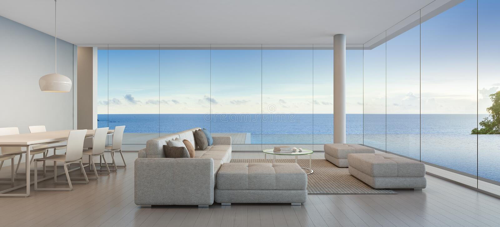Dining and living room of luxury beach house with sea view for Ville con grandi vetrate