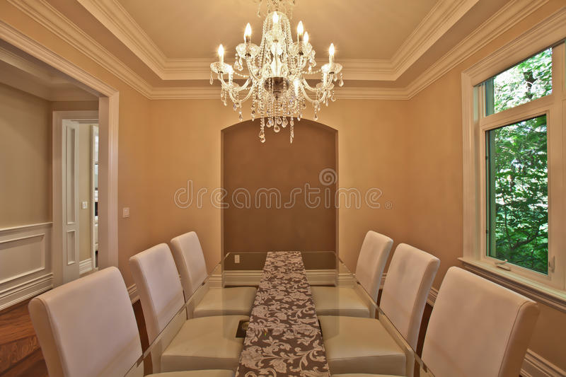 Dining room. Elegant dining room in a luxury house royalty free stock photography