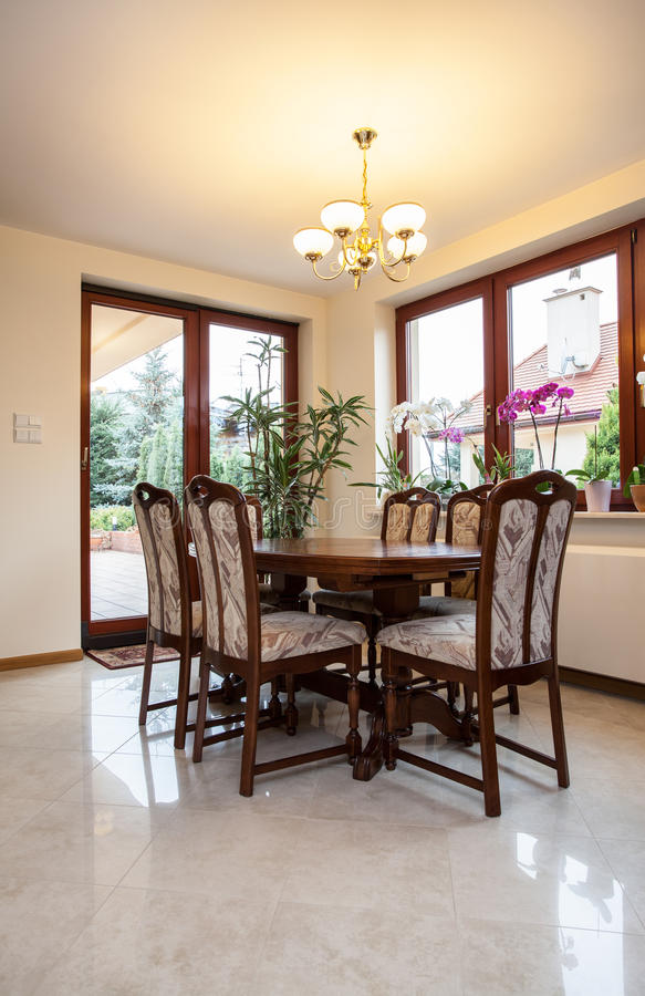 Dining room. View of a wooden table in dining room royalty free stock images