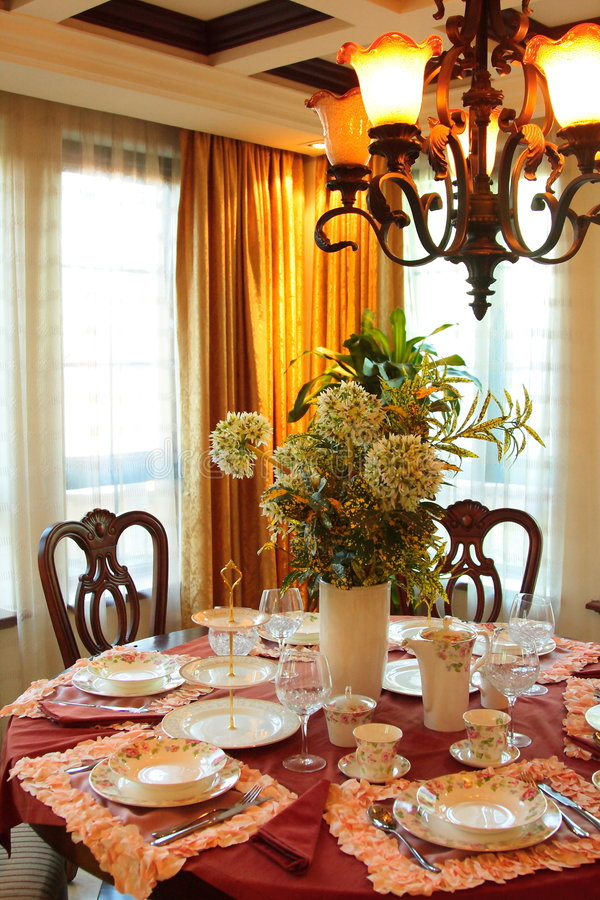 Dining Room. With table, chairs, or chandelier, or windows stock photos