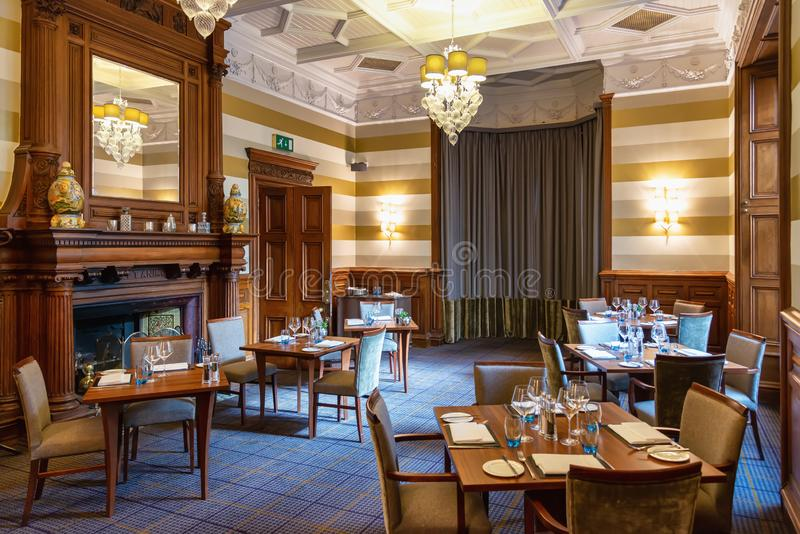 Dining room at Ardoe House Hotel in Aberdeen, United Kingdom. Aberdeen, United Kingdom - August 17, 2014: Luxury dining room interior at Ardoe House Hotel in stock image