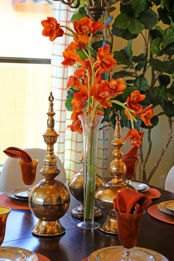 Dining room. Beautiful color coordinated dining room with flower centerpiece royalty free stock photos