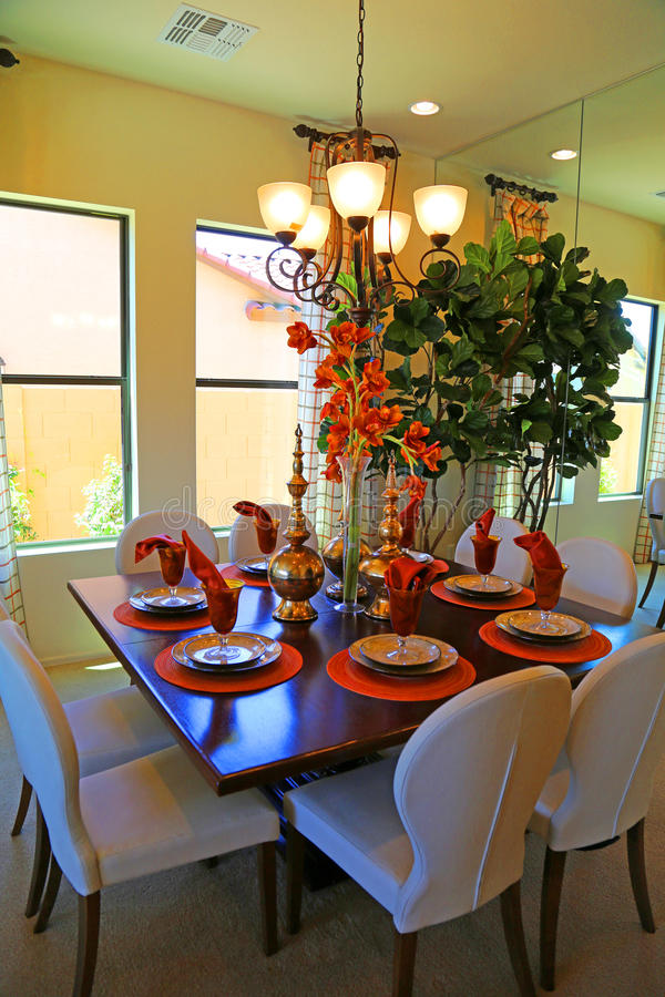 Dining room. Beautiful color coordinated dining room with flower centerpiece stock photography