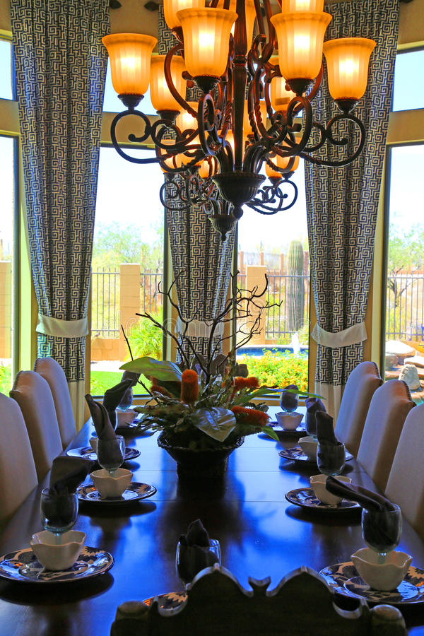 Dining room. Beautiful color coordinated dining room with flower centerpiece royalty free stock images
