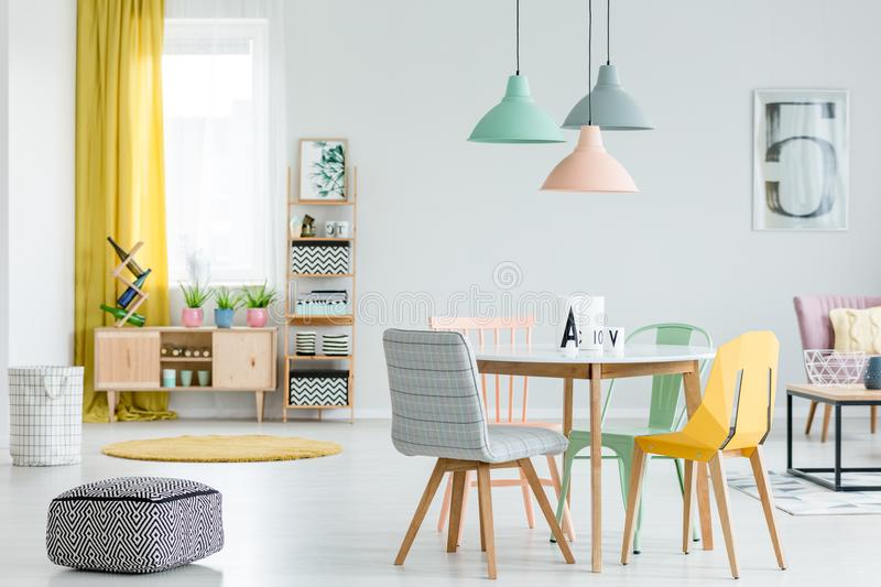 Dining room with colorful chairs royalty free stock photography
