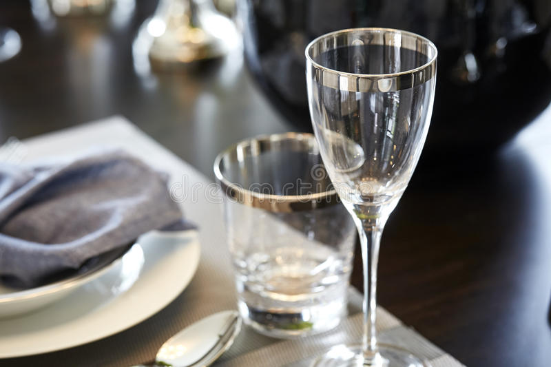 Dining room. Empty glasses set in dining room stock images