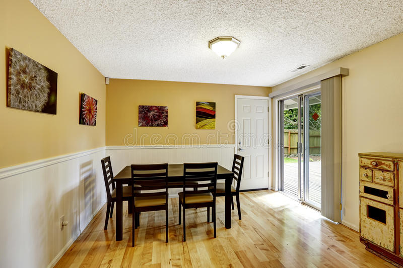 Dining Room With Exit To Backyard Patio Area Stock Image