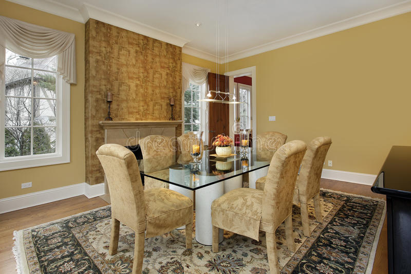 Dining room with gold walls. And fireplace royalty free stock images