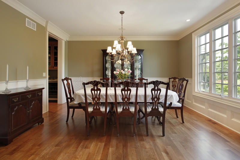 Dining room with gold walls. Dining room in suburban home with gold walls stock photography