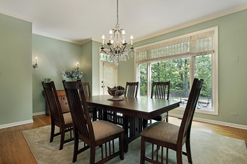 Dining room with green walls stock photo image of for Dining room ideas green