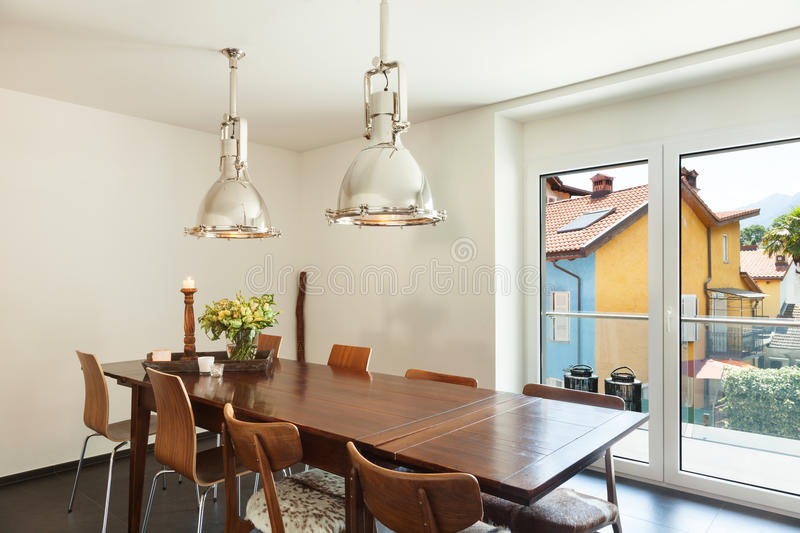 Dining room. Interior modern house, beautiful decor, dining table royalty free stock photo