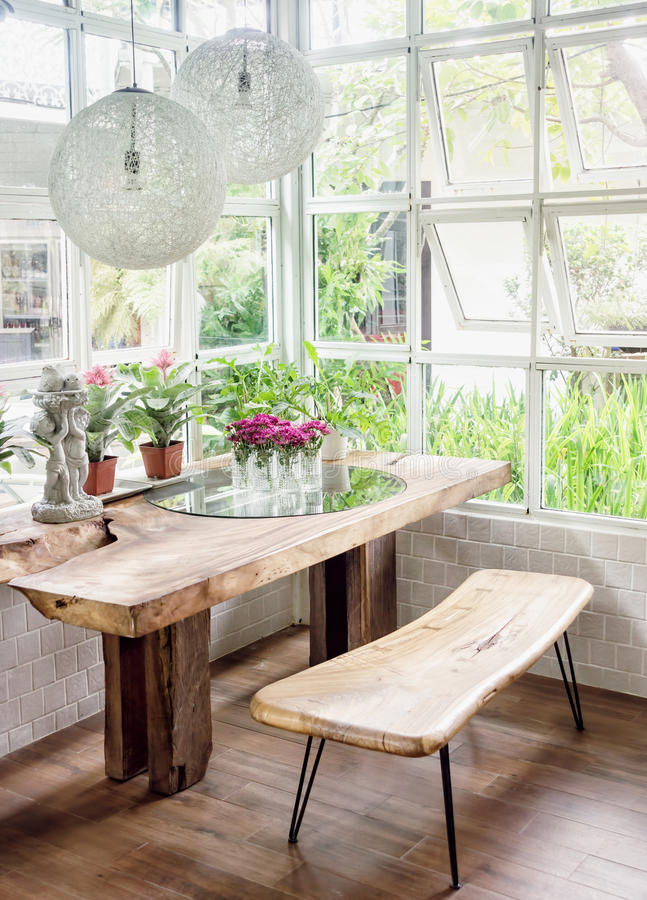 Dining Room Interior With Table, Chairs And Plants Against ...