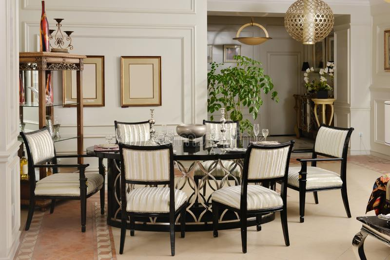 Dining room luxury furniture appliance. Luxury dining room furniture in villa royalty free stock photos