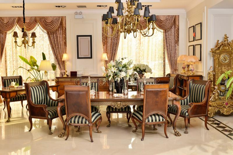 Dining room luxury furniture home appliance fitment. Luxury dining room furniture in villa stock photography