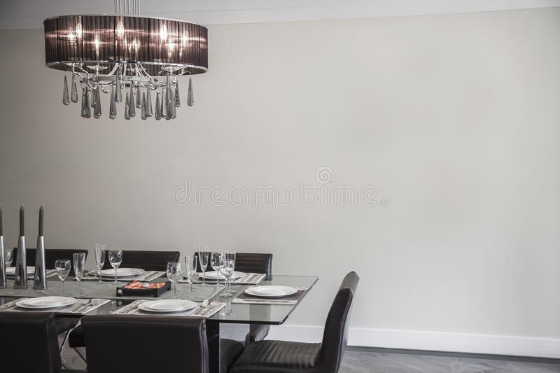 Dining room with modern furniture and chandelier. royalty free stock photography