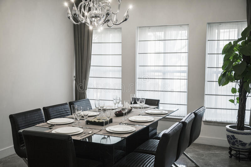 Dining room with modern furniture and chandelier. stock photos