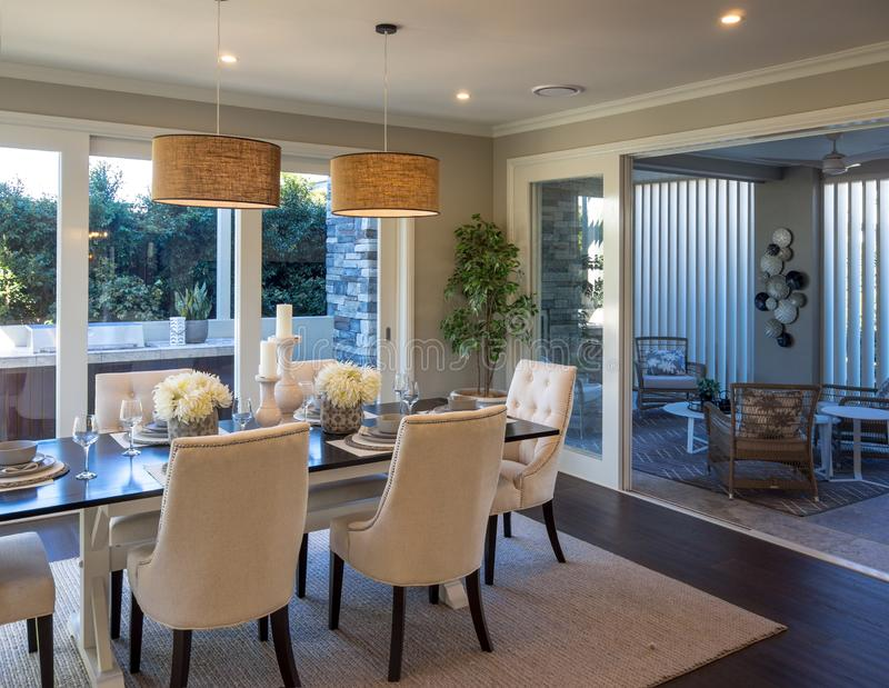 Dining room next to out door room looking out outside to BBQ grill royalty free stock photos