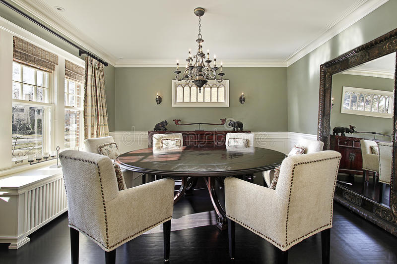 Dining room with olive walls royalty free stock images