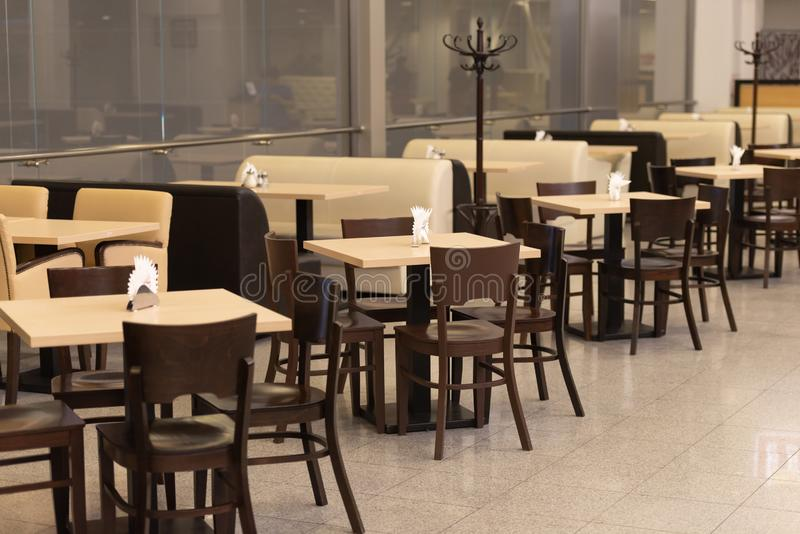 Tables and chairs in a row. Dining room before opening. Furniture for cafes. Crocus-Expo royalty free stock photography