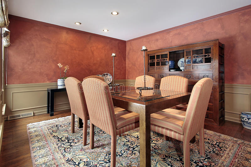 Dining room with orange walls stock photos