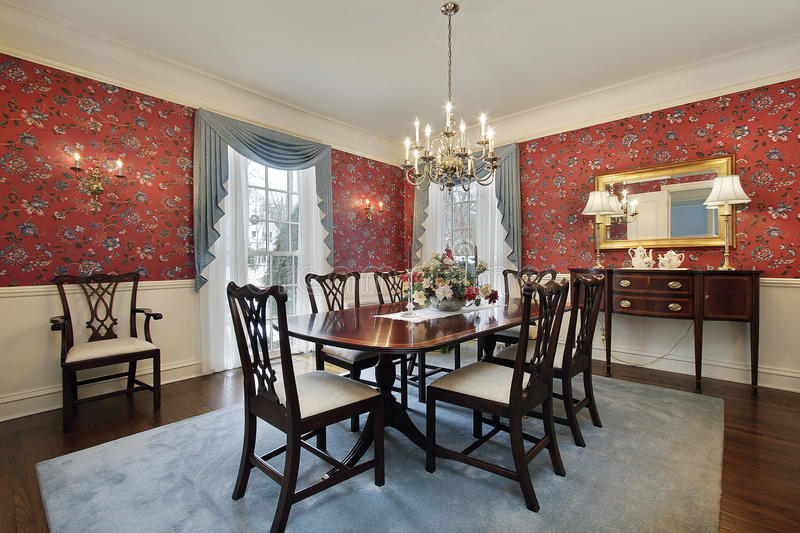Dining room with red floral wallpaper royalty free stock photo