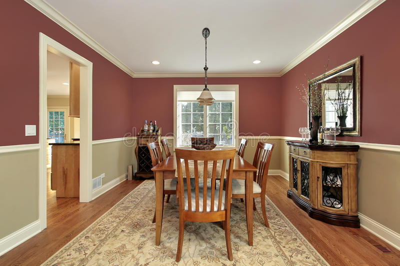 Dining room with two toned walls. Dining room in suburban home with two toned walls royalty free stock image