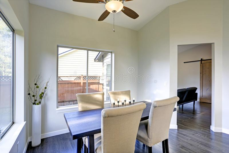 Dining room interior with backyard view. royalty free stock photography