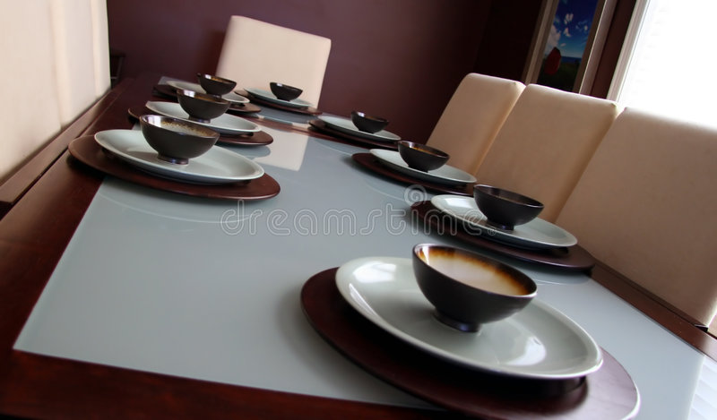 Dining Table. Elegant dining table in chocolate brown and blue, with matching dinnerware stock image