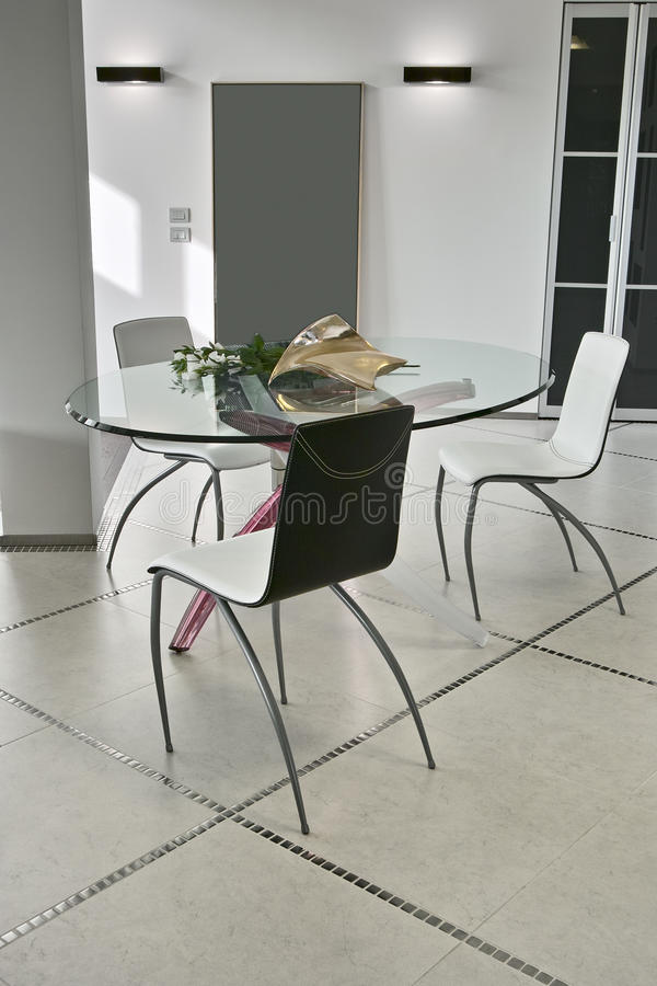 Dining table and chair in the modern living room royalty free stock images