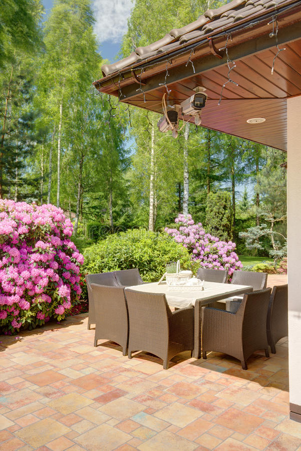 Dining table in the garden. Dining table in the modern designed garden stock images