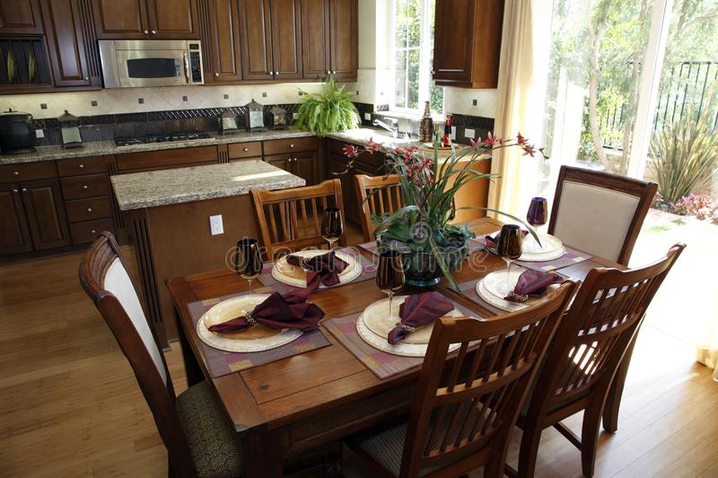 Dining table and kitchen. stock image
