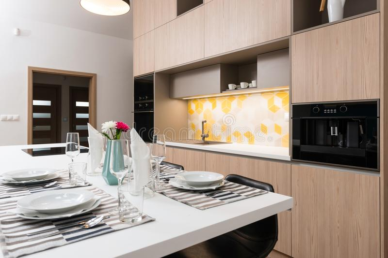 Dining table in kitchen. Dining table in contemporary kitchen stock photos