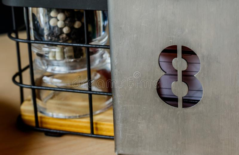 Dining table number eight in the restaurant. stock images