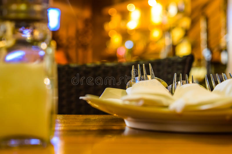 Dining table set close up with yellow bokeh backgr royalty free stock photos