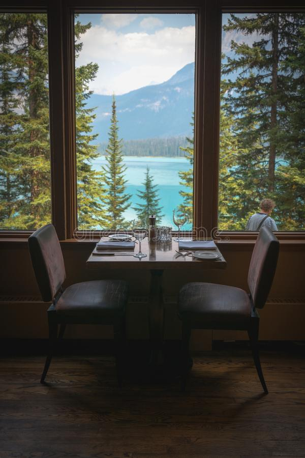 Dining table set in the restaurant with Emerald Lake view, CANADA stock photo