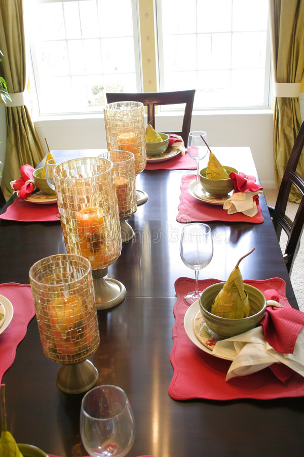 Dining table set up. Dining table setting with candle holders, glasses and bowls stock images