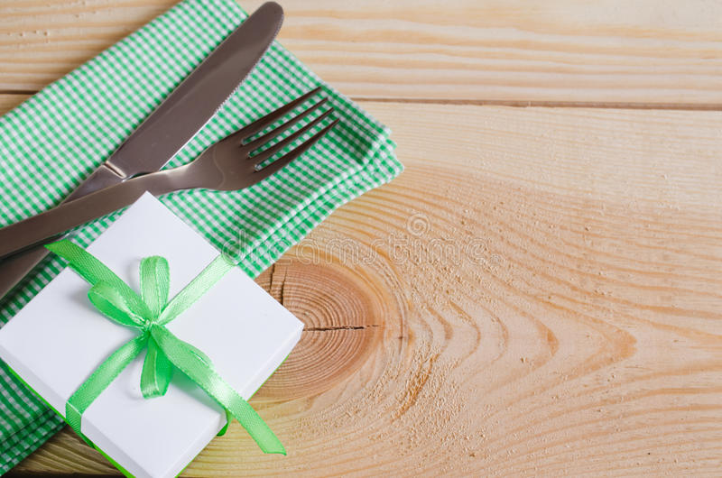 Dining Table Setting. Cutlery with Empty Tag and Present. Dining Table Setting. Cutlery with Empty Tag and Present on Linen Napkin on Rustic Wooden Background stock photos