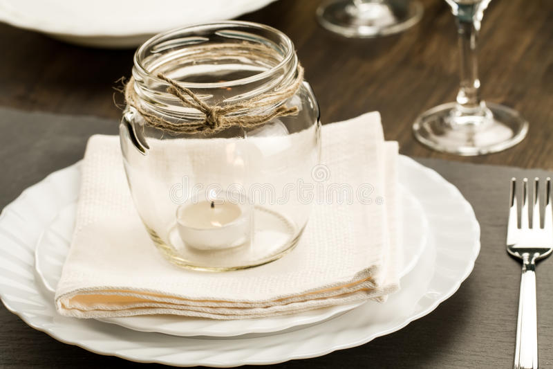 Dining table setting. With glasses and candle stock photos