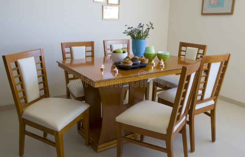 Dining table with six chairs. Color peach stock photos