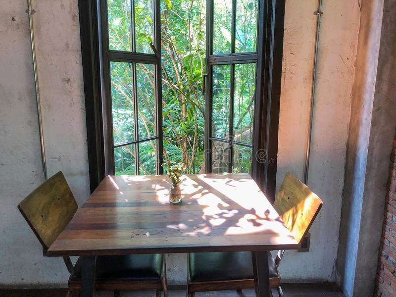 Dining tables and chairs in the vintage house stock photo