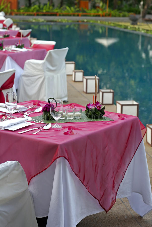 Dining tables near pool