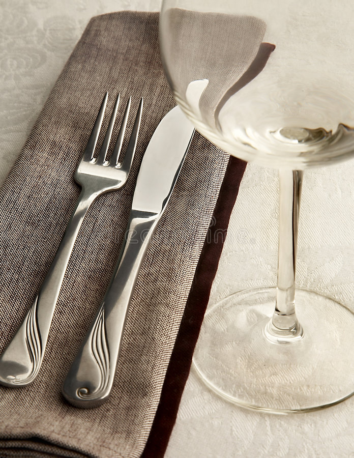 Before dinner. Stillife with fork, knife and glass stock photo
