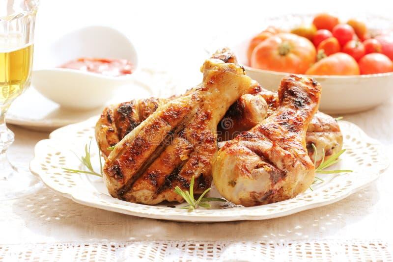 Dinner background. Grilled chicken drumsticks . stock image