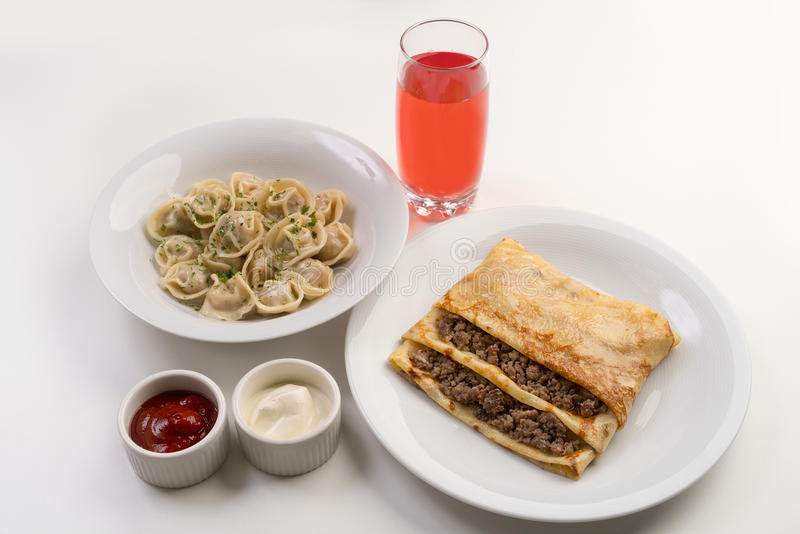 Dinner with dumplings and crepe filled with meat royalty free stock photos