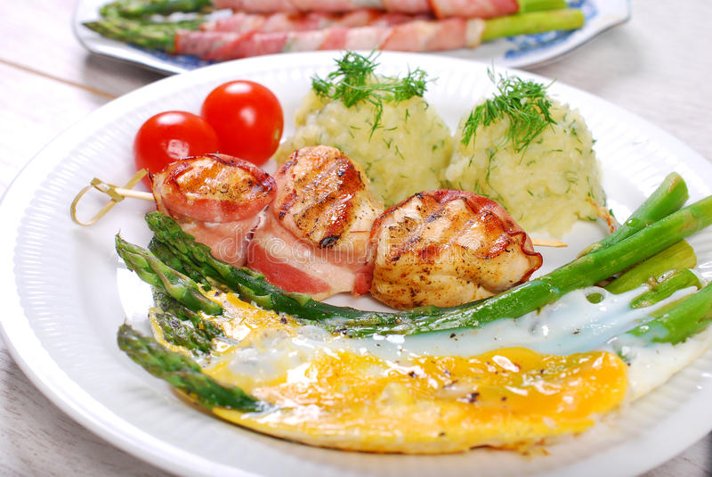 Dinner With Green Asparagus Baked On Eggs Stock Photo ...