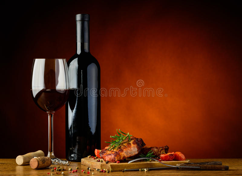 Dinner with grilled steak and wine stock photos