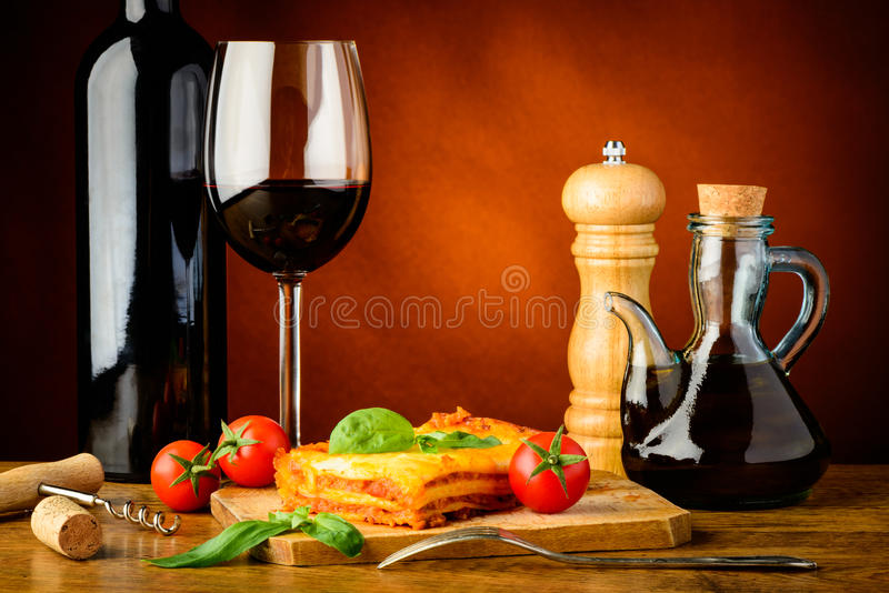 Dinner with lasagna and red wine royalty free stock photo