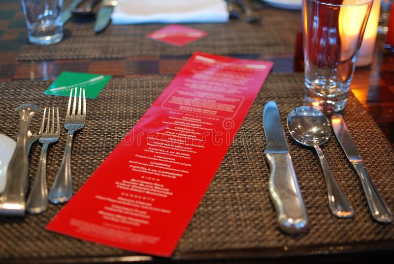 A dinner menu on the red paper stock photo