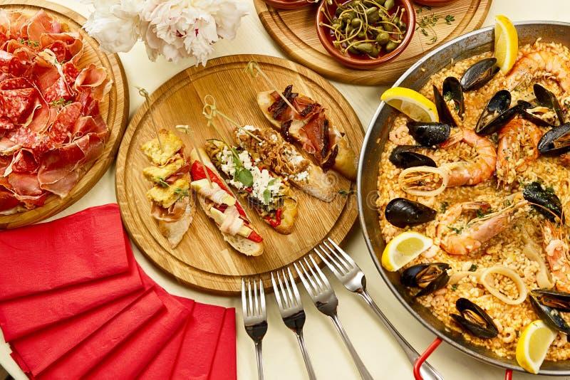 Dinner with paella stock photos